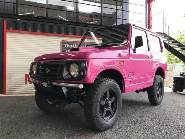 スズキ XLリミテッド 4WDオートマ リフトアップ 社外マフラー 社外ハンドル バンパー HID 内外装ピンク仕上げ バックカメラ 革調シートカバー MTタイヤ