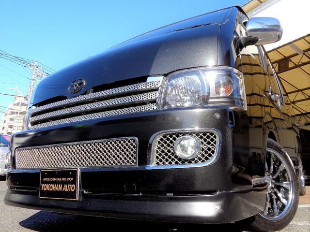 トヨタ ロングワイドスーパーGL 1オーナー公認乗用登録8人3列ロングスライドフルフラットナビTV後席TVセキュリティエアロLED黒革黒木目