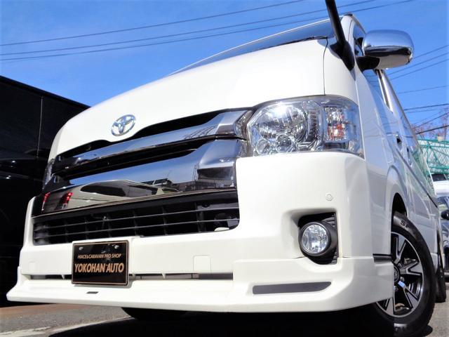 トヨタ ロングワイドスーパーGL 4型3.0DTダークプライム1オーナー禁煙ナビTV2モニターDレコーダー電動ドアスマートキーエアロLED15AW革調黒木目後席板張