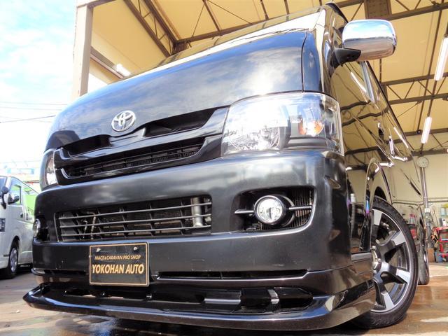 トヨタ ハイエースバン ロングスーパーGL 3.0ディーゼルターボ1オーナーHDDフルセグバックカメラエアロBKインナーLEDライト18AWローダウン黒革調シート2回目Tベル交換済