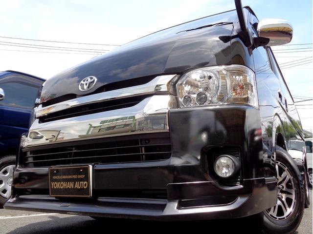 トヨタ ハイエースバン ロングワイドスーパーGL 4型ダークプライム6AT車内泊1オーナーナビTVバックカメラ後席TV電動ドアスマートキーエアロLEDライト15AW専用レザー黒木目ベットキット