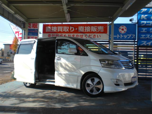 トヨタ AS 7人乗 両側自動ドア ツインHDDナビ 黒革シートカバ