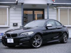 BMWM235iクーペ 1オナ 赤革 Pアシスト 自動B 新車保証