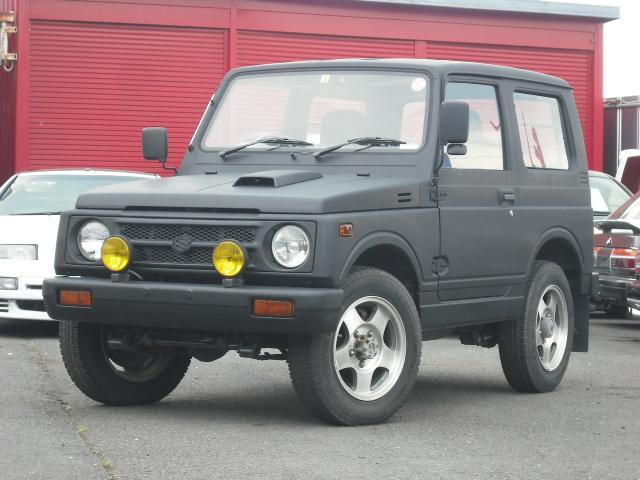 スズキ ジムニー ワイルドウインドリミテッド 4WDターボ 黒革調シートカバー MOMOハンドル ETC