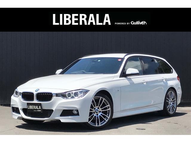 BMW 3シリーズ 320dツーリング Mスポーツ インテリSFT 車線逸脱警告 クルコン 純正ナビ Bカメラ 電動リアゲート パワーシート パドルシフト オートライト HIDライト 純19インチAW ルーフレール 社外レーダー コンフォートアクセス