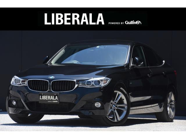BMW 3シリーズ 320iグランツーリスモ 純正HDDナビBカメラフットトランクオープナー電動バックドアアイドリングストップMTモード付きATD/Nパワーシート純正18インチAWコーナーセンサーキャリア積載電格ミラープッシュスタートオートライト