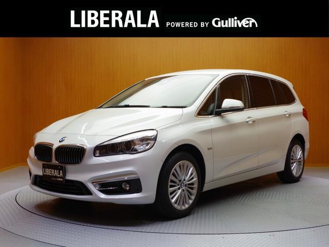 BMW 2シリーズ 218iグランツアラー ラグジュアリー 茶革シート/前席Pシート/前シートヒーター/追従クルコン/HUD/パワーバックドア/Bカメラ/クリアランスソナー/コンフォートA/純正HDDナビ/新車時保証書/取説
