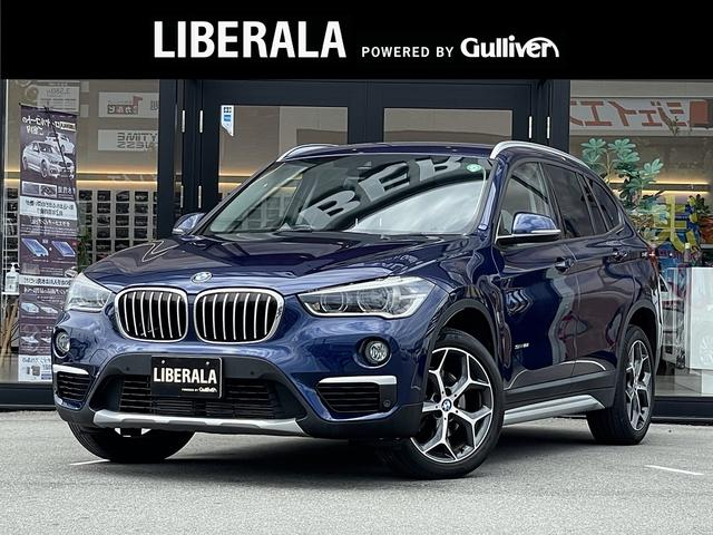 BMW X1 sDrive 18i ・アクティブクルーズコントロール・純正HDDナビ/CD/DVD/USB/BT・バックカメラ・黒革シート/PWシート/シートヒーター・コンフォートアクセス・純正18AW・オートライト・ETC