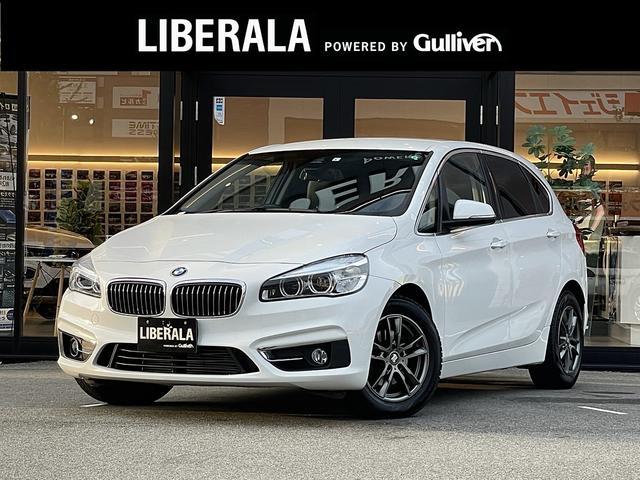 BMW 2シリーズ 218dアクティブツアラー ラグジュアリー ・1オーナー・純正HDDナビ/CD/DVD/USB/AUX/BT・バックカメラ・黒革シート/シートヒーター・コンフォートアクセス・PWバックドア・社外16AW・LEDライト・DVDキャンセラー