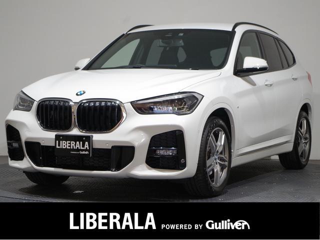 BMW X1 sDrive 18i Mスポーツ 後期/1オーナー/ACC/電動リアゲート/禁煙車/ETC/インテリジェントセーフティ/純正ナビ&リアカメラ/パワーシート/コーナーセンサー/純正18インチAW/コンフォートアクセス/LEDライト