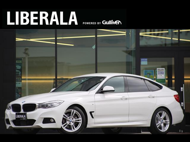 BMW 320iグランツーリスモ Mスポーツ ACC/レーダーセーフティPKG/電動リアゲート/ETC/禁煙車/純正ナビ&リアカメラ/パワーシート/純正18インチAW/コンフォートアクセス/キセノン/コーナーセンサー/