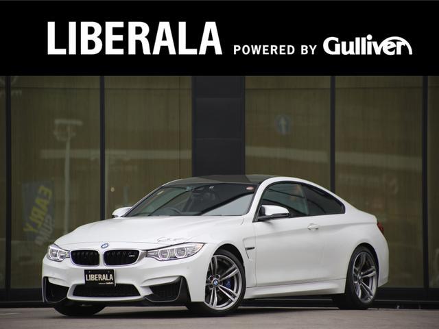BMW M4クーペ カーボンルーフカーボントランクスポイラー純正ナビバックカメラ黒革フルセグ純正19inAWシートヒータースマートキーLKAクルーズコントロールレーンキープアシストブラインドスポットアシストGPSレーダー
