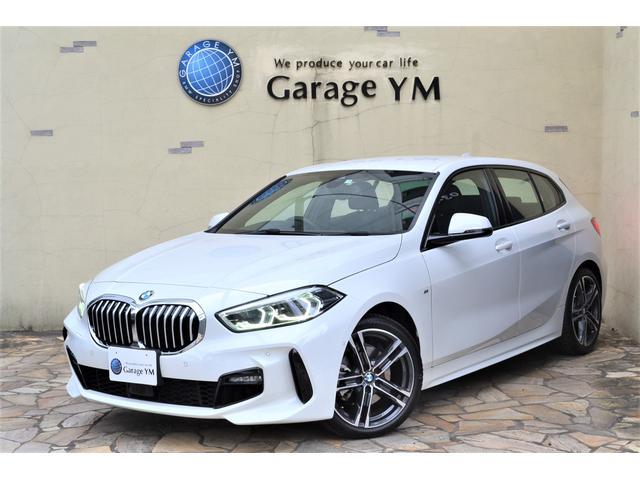 BMW 118i Mスポーツ ・デジタルキー・ワイヤレス充電・ナビパッケージ・コンフォートP(オートマチックレールゲート・ACC)・ストレージP・Bカメラ・PDC・Pサポ・ハイビームアシスト・新車保証