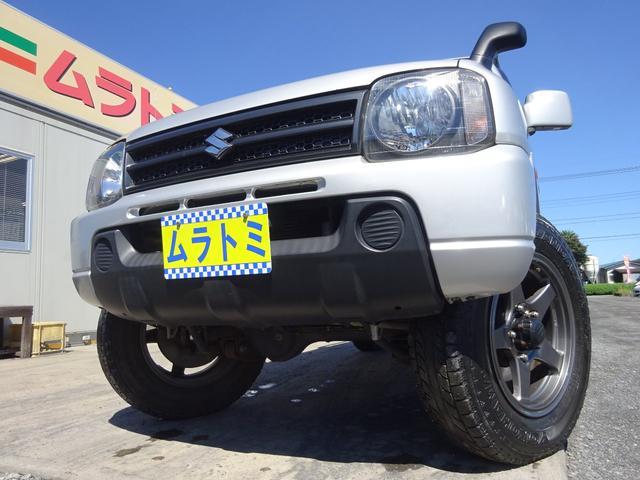 スズキ XG 4WD ターボ 5MT車 8型 APIO足回りリフトアップ フジツボマフラー 社外16インチアルミホイール 背面タイヤ ステアリングダンパー 社外スピーカー キーレスキー ETC ルーフキャリア