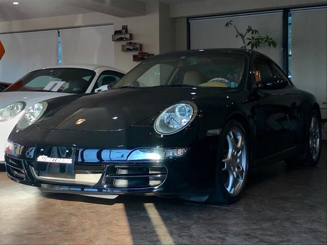 ポルシェ 911 911カレラ ティプトロニック 茶レザー クーペ 左ハンドル