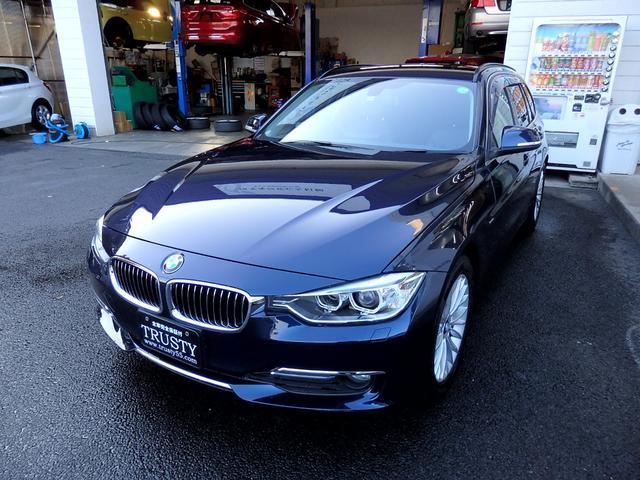 BMW 3シリーズ 320dブルーパフォーマンス ツーリングラグジュアリ 純正18インチAW ブラックレザー HDDナビ Mサーバー AUX USB ETC バックカメラ リアPDC スマートキー バイキセノン シートヒーター メモリーパワーシート Pリアゲート 1年保証
