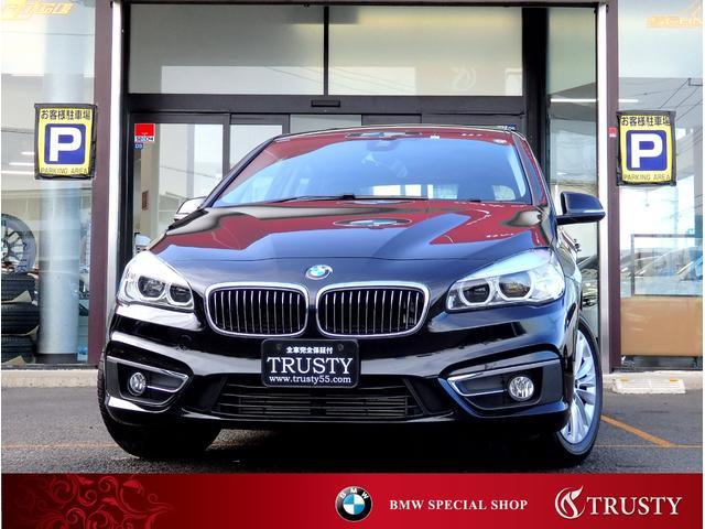 BMW 218iアクティブツアラー ラグジュアリー 1オーナー パーキングサポートPKG 純正16AW タイヤ8分山 ブラックレザー HDDナビ USB ブルートゥース LEDヘッドライト シートヒーター Dアシスト マルチステア 2ゾーンAC 禁煙車