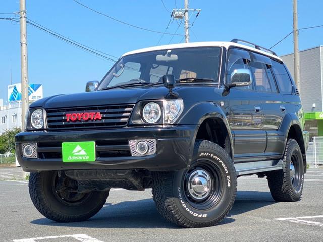 トヨタ ランドクルーザープラド TXリミテッド リフトアップ・サクソンマフラー・社外グリル リフトアップ・サクソンマフラー・社外グリル・社外ヘッドライト・フリップダウンモニタ・ナビ・フルセグ・Bluetooth・シートカバー・ ETC・背面タイヤ・キーレス・バックカメラ