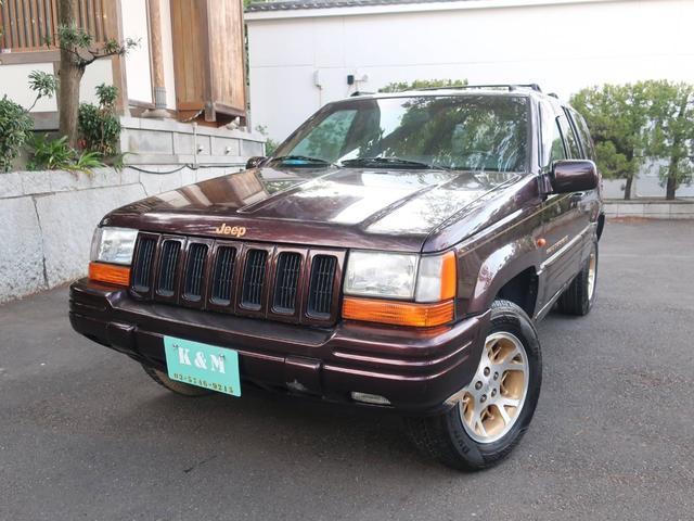 クライスラー・ジープ リミテッドLX 4WD 革シート AW 禁煙車 5名乗り クルコン パワーシート ブラウン AT AC 左ハンドル