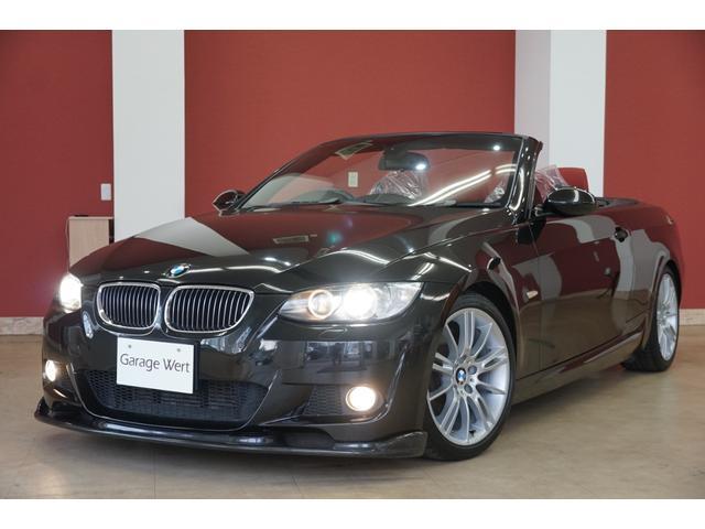 BMW 335iカブリオレMスポーツパッケージ 7速DCT・赤革シート・純正ナビ・カーボンフロントリップスポイラー・電動オープン・ETC・HIDライト・パーキングセンサー