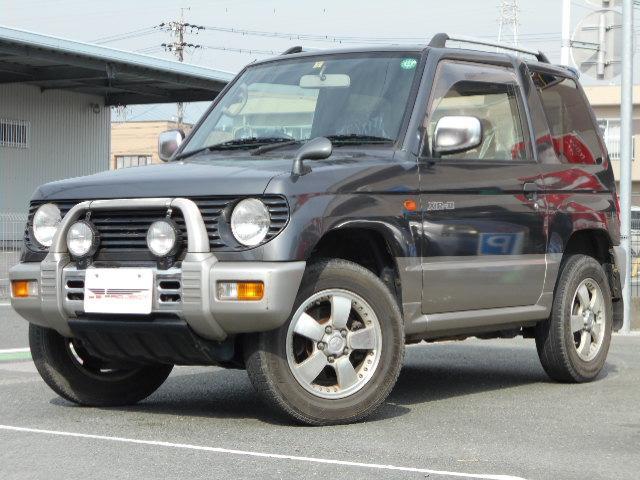 三菱 アニバーサリーリミテッド-X オートマ車 4WD 背面タイヤ