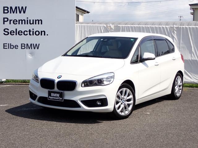 BMW 218iアクティブツアラー ファッショニスタベージュ革社外地デジコンフォートA電動Gシートヒータ ウッドパネル Rフィルム LED