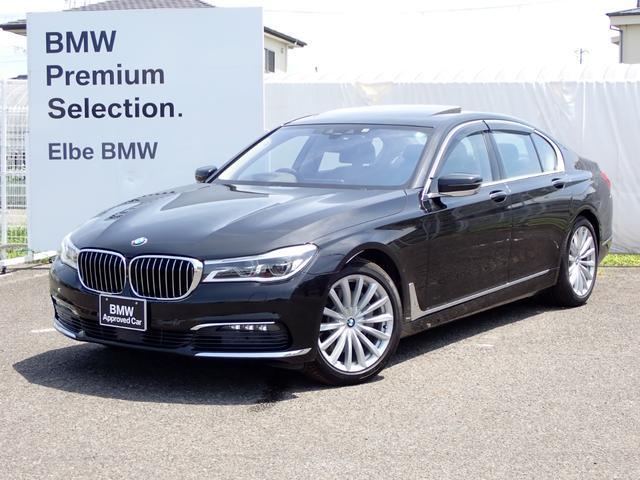 BMW 740i プラスPハーマンカードンサンルーフHUDウッドハンドル 黒革 シートヒータ 電動トランク