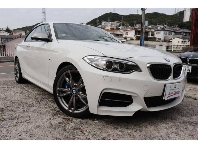 BMW M235iクーペ 2年長期無料保証付 パドルシフト カーボンスポイラー 衝突軽減警告 車線逸脱警告 純正ナビ バックカメラ クリアランスソナー  パーキングサポート コンフォートアクセス