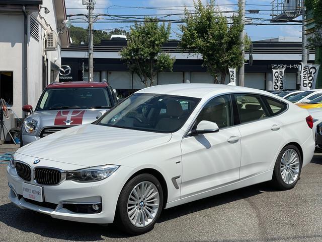 BMW 320iグランツーリスモ ラグジュアリー ワンオーナー ベージュレザーシート シートヒーター キセノンヘッドライト ミラーETC 18インチアルミ HDDナビ バックカメラ パワーバックドア 記録簿5枚 取説保証書 スペアキー正規ディーラー車