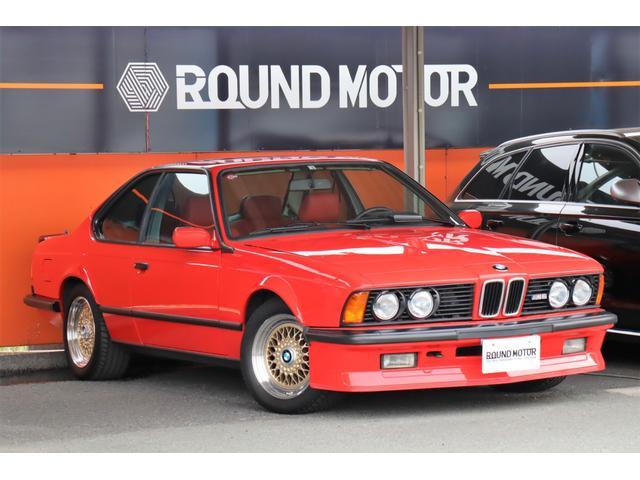 BMW  ・左H・5速MT・シート&ドアトリム赤革張替・ルーフ張替・パワーシート・サンルーフ・革巻きハンドル・15インチアルミホイール・トランクスポイラー・CD・Bluetooth・ETC