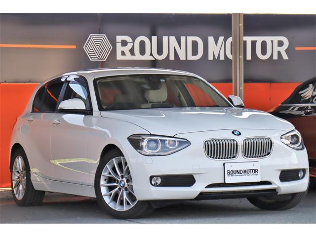 BMW 1シリーズ 116i ファッショニスタ 1年保証付・衝突警告・フルセグ・ナビ・Bカメラ・ETC・スマートキー・ベージュ本革シート・17AW・クルコン・アイドリングストップ・Bluetooth・シートヒーター・リアソナー・コネクトドライブ