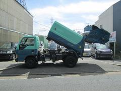 エルフトラックパッカー車 巻き込み回転式ダンプ 3.4t積6.4立米