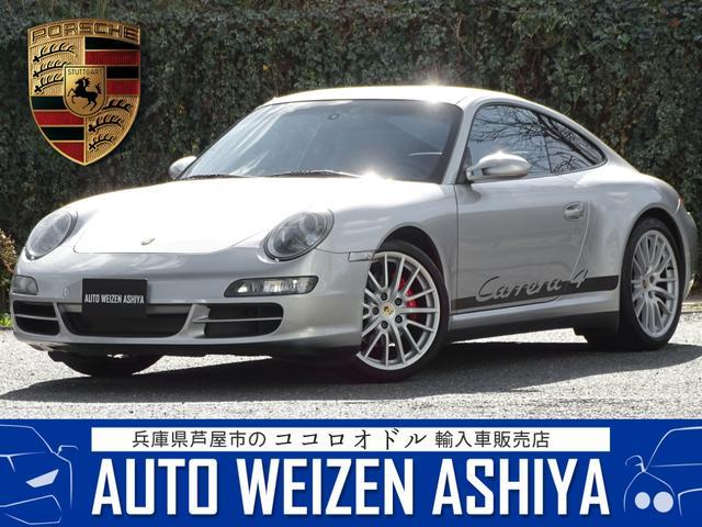 ポルシェ 911カレラ4 D車左 6速 4WD黒革ナビSエグゾPASM