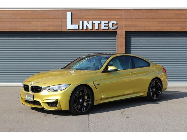 BMW M4クーペ 左ハンドル 6速MT Mカーボンセラミックブレーキ アダプティブMサスペンション フロントバンパープロテクションフィルム ヘッドアップディスプレイ 前席シートヒーター 前後ドライブレコーダー 禁煙車