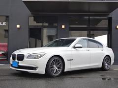 BMW740I 社外19インチAW黒本革Sサンルーフ正規D左H