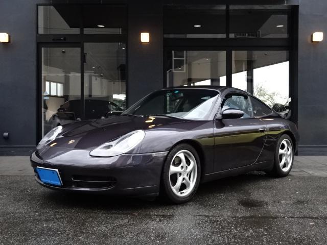 ポルシェ 911カレラ 正規ディーラー車 左ハンドル 6速MT グレー革シート 純正AW 電動リアウイング ETC