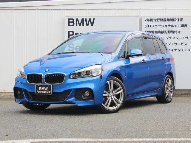 BMW 2シリーズ 218dグランツアラー Mスポーツ コンフォートパッケージ ワンオーナー LEDヘッドライト i-Driveナビゲーション バックカメラ PDCセンサー スポーツレザーステアリング シフトパドル付 社外ドラレコ リヤ3面スモーク貼 サンバイザー付