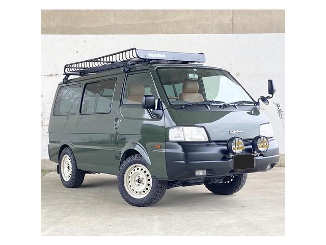 日産 DX 4WD 5速マニュアル車 全塗装済 ゴツゴツタイヤ レザー調ブラウンシートカバータイミングベルト一式、ウォーターポンプ交換済み