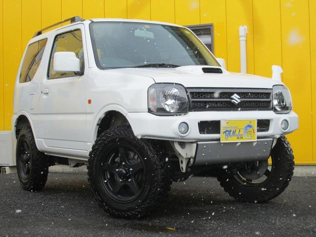 スズキ ジムニー XC 4WDマニュアル リフトアップ 社外16インチAW マッドタイヤ 社外前後バンパー フォグ付き 社外マフラー ワンオーナー