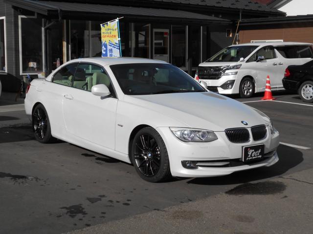 BMW 335iカブリオレ 純正HDDナビゲーション/フルセグTV/パドルシフト/クルーズコントロール/ETC/CD・DVD再生可/電動シート・シートヒーター・レザーシート/2ドアオープン/ユーザー買取車/取り扱い説明書あり