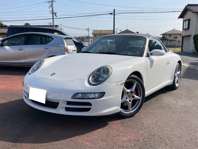 ポルシェ 911 911カレラ カブリオレ ナビ フルセグTV 左ハンドル バックカメラ 18AW オーディオ付 DVD ETC 4名乗り オープンカー ホワイト