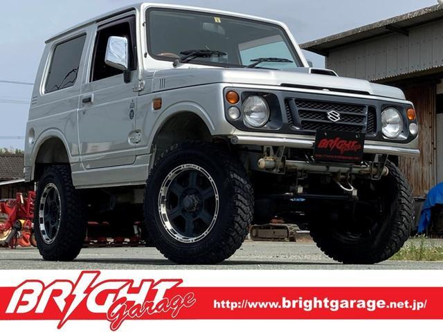 スズキ ジムニー XL 4WD 5速MT ロールバー 16インチAW MTタイヤ ポータブルナビ ワンセグTV ウッド調ハンドル