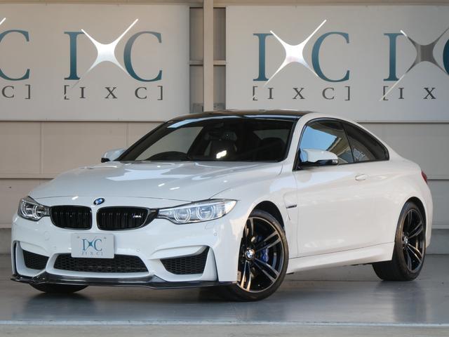 BMW M4クーペ 7速DCT(AT) Fスポイラー トランクスポイラー 純正OP19AW カーボンルーフ 黒本革Pシート シートヒーター HDDナビ iドライブ フルセグTV Bカメラ Bluetooth対応1オーナー