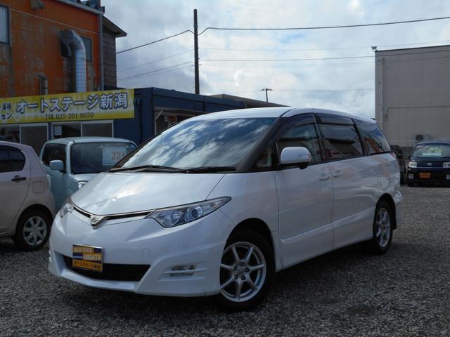 トヨタ 2.4アエラス Gエディション 4WD 両側電動スライドドア HDDナビ フルセグTV サイド・バックカメラ 後席モニター ETC プッシュスタート オットマン付き