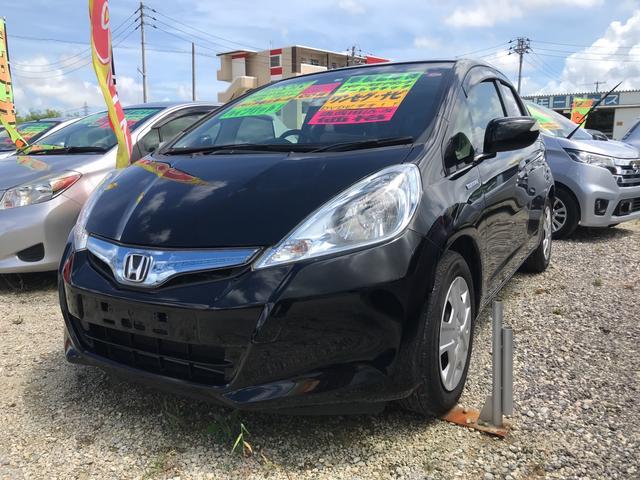 沖縄の中古車 ホンダ フィットハイブリッド 車両価格 55万円 リ済込 2013(平成25)年 7.4万km ブラック
