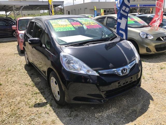沖縄の中古車 ホンダ フィットハイブリッド 車両価格 49万円 リ済込 2012(平成24)年 6.0万km ブラック