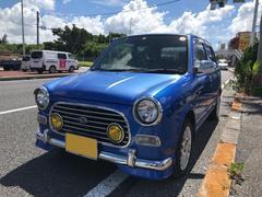 沖縄の中古車 ダイハツ ミラジーノ 車両価格 29万円 リ済込 平成14年 12.7万K ブルーM
