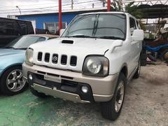 沖縄の中古車 スズキ ジムニー 車両価格 24万円 リ済込 平成13年 12.9万K パールII