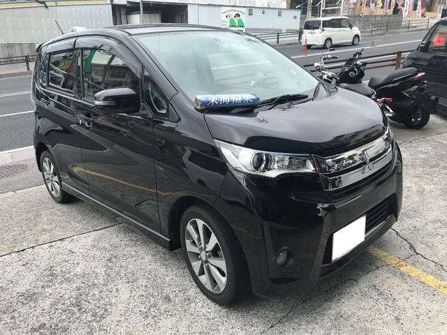 沖縄の中古車 三菱 eKカスタム 車両価格 49万円 リ済込 2013(平成25)年 11.2万km ブラック