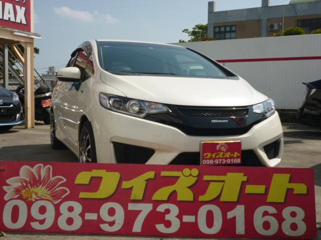 沖縄の中古車 ホンダ フィットハイブリッド 車両価格 78万円 リ済別 2014(平成26)年 9.2万km パールホワイト
